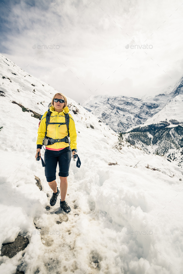 Woman hiker walking in Himalaya Mountains, Nepal - Stock Photo - Images