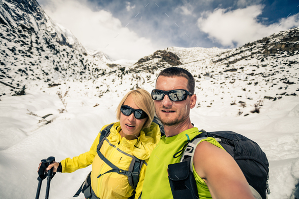Couple hikers selfie portrait in winter mountains - Stock Photo - Images
