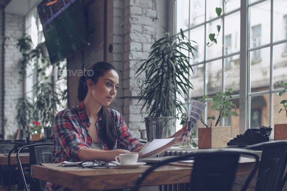 Working girl in cafe - Stock Photo - Images