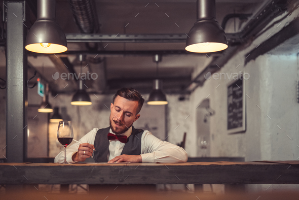 Young man in cafe - Stock Photo - Images