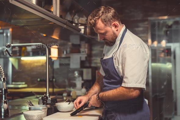 Chef preparing indoors - Stock Photo - Images