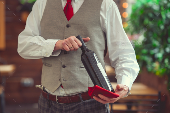 Sommelier with a bottle of wine - Stock Photo - Images