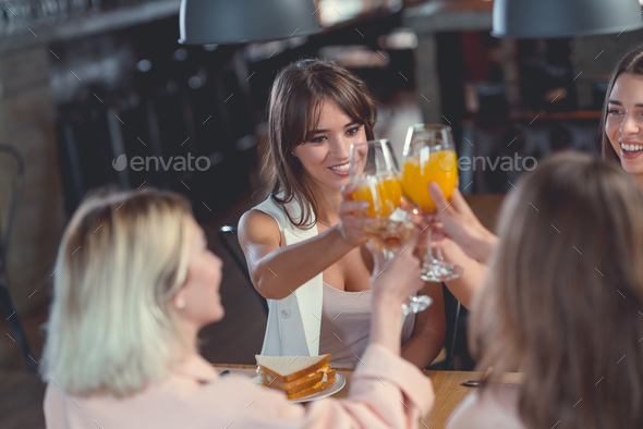 Happy girls in a cafe - Stock Photo - Images