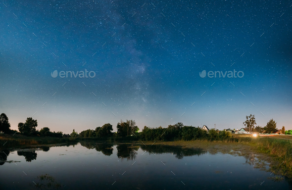 Night Starry Sky With Milky Way Galaxy Above Russian Village. Ni - Stock Photo - Images