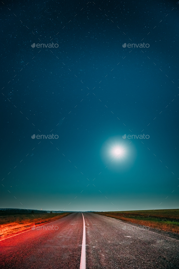 Night Starry Sky With Moon Above Country Asphalt Road In Country - Stock Photo - Images