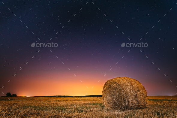 Night Starry Sky Above Field Meadow With Hay Bale After Harvest. - Stock Photo - Images