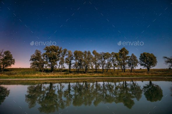 Blue Night Starry Sky Above Lake River. Night Glowing Stars And - Stock Photo - Images