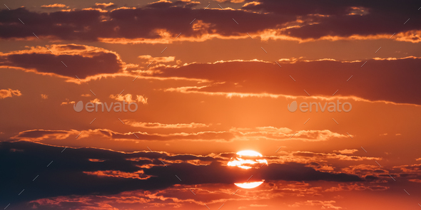 Bright Orange And Yellow Warm Colors Sun In Sunset Sunrise Sky C - Stock Photo - Images