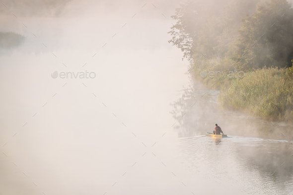 Calm Lake, River And Man Fishing From Old Wooden Rowing Fishing - Stock Photo - Images