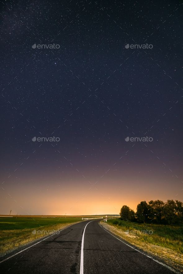 Night Starry Sky Above Country Road In Countryside And Green Fie - Stock Photo - Images
