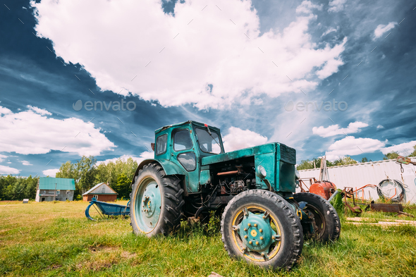 Old Tractor Parking In Backyard In Summer Sunny Day. Special Agr - Stock Photo - Images