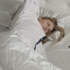 Girl and Smartphone Are Lying on the Bed - VideoHive Item for Sale
