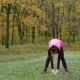 Beautiful Fitness Sport Girl Does Warm Up Before Running in Autumn Park Workout Outdoors - VideoHive Item for Sale