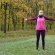 Beautiful Fitness Sport Girl Does Warm Up Before Running in Autumn Park. Workout Outdoors. - VideoHive Item for Sale