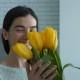 Lovely Woman Enjoying Smell of Flowers Given By Man - VideoHive Item for Sale