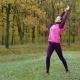 Beautiful Fitness Sport Girl Does Warm Up Before Running in Autumn Park. Workout Outdoors - VideoHive Item for Sale