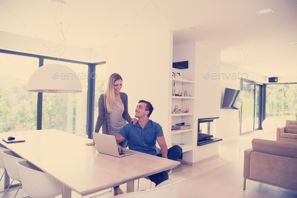 couple using laptop at home - Stock Photo - Images