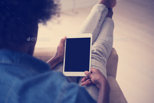 african american woman at home with digital tablet - Stock Photo - Images
