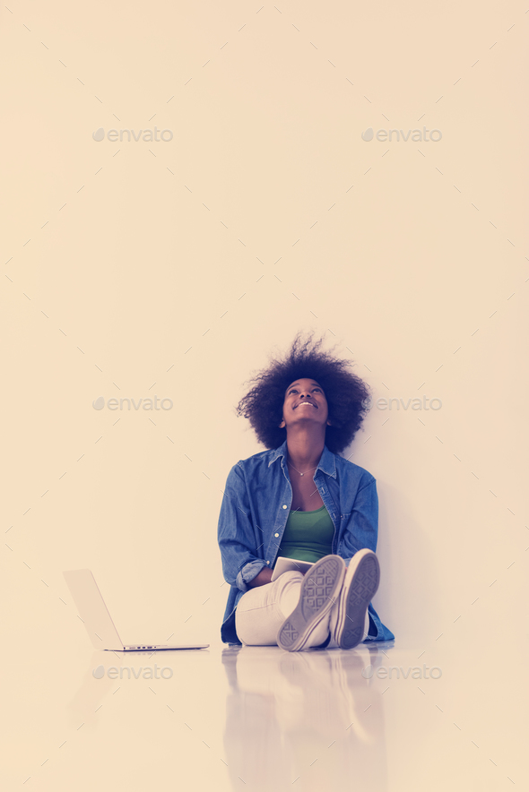 african american woman sitting on floor with laptop - Stock Photo - Images