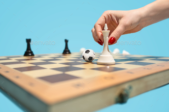 soccer ball of chess pieces on the board - Stock Photo - Images