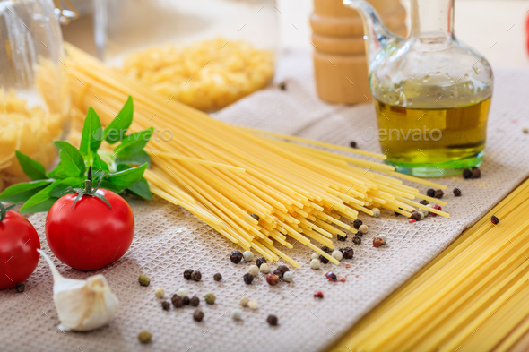 Raw spagetti pasta with vegetables - Stock Photo - Images
