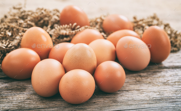 Eggs on a wooden surface - Stock Photo - Images