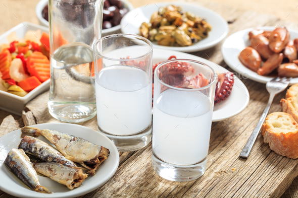 Two glasses of ouzo and appetizers - Stock Photo - Images