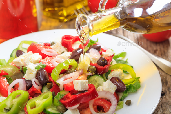 Greek salad on wooden background - Stock Photo - Images