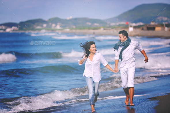 happy young couple have fun at beautiful beach - Stock Photo - Images