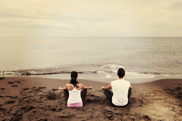 couple yoga beach - Stock Photo - Images