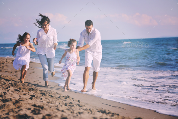 happy young  family have fun on beach - Stock Photo - Images