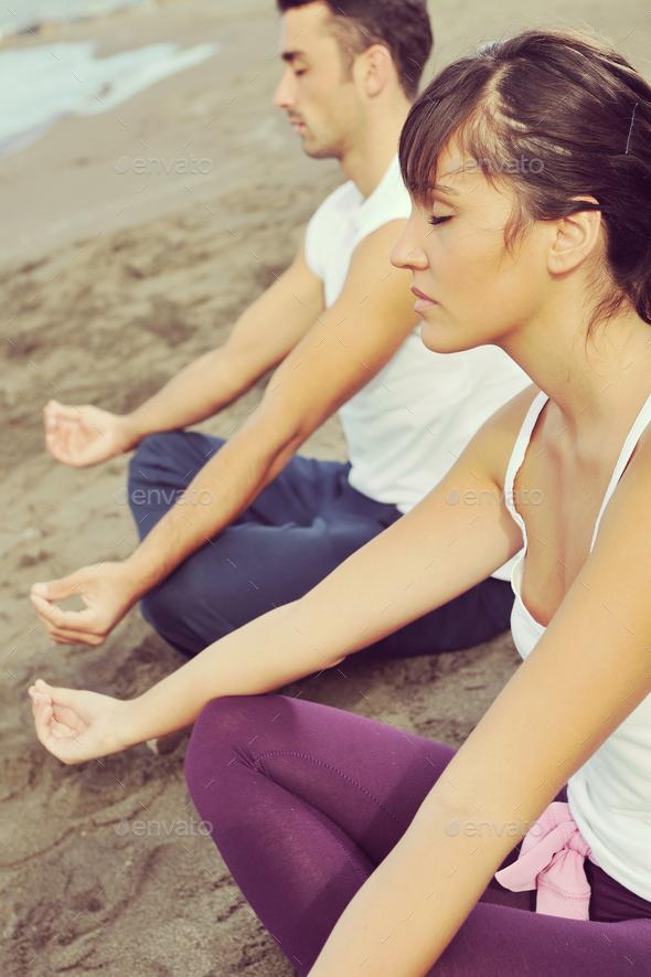 couple yoga beach - Stock Photo - Images