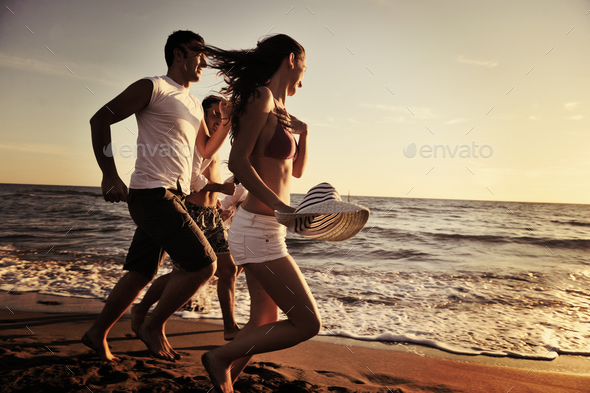 people group running on the beach - Stock Photo - Images