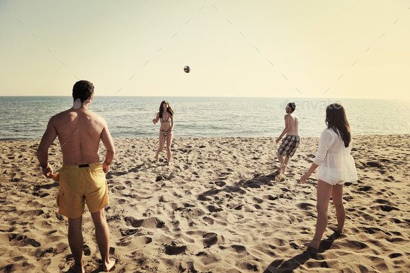 young people group have fun and play beach volleyball - Stock Photo - Images