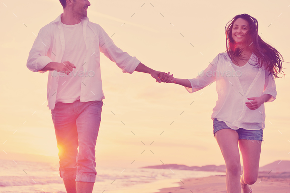 young couple  on beach have fun - Stock Photo - Images