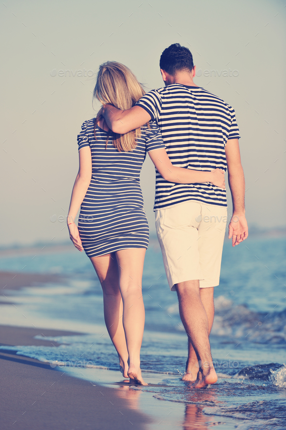 happy young couple have romantic time on beach - Stock Photo - Images
