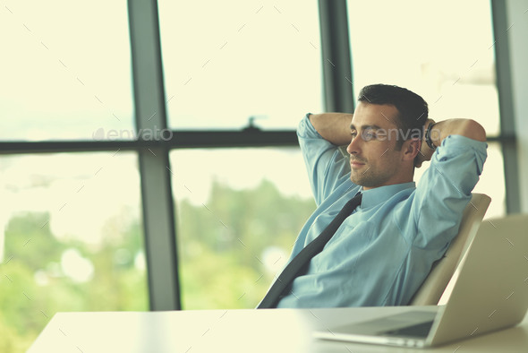 happy young business man at office - Stock Photo - Images