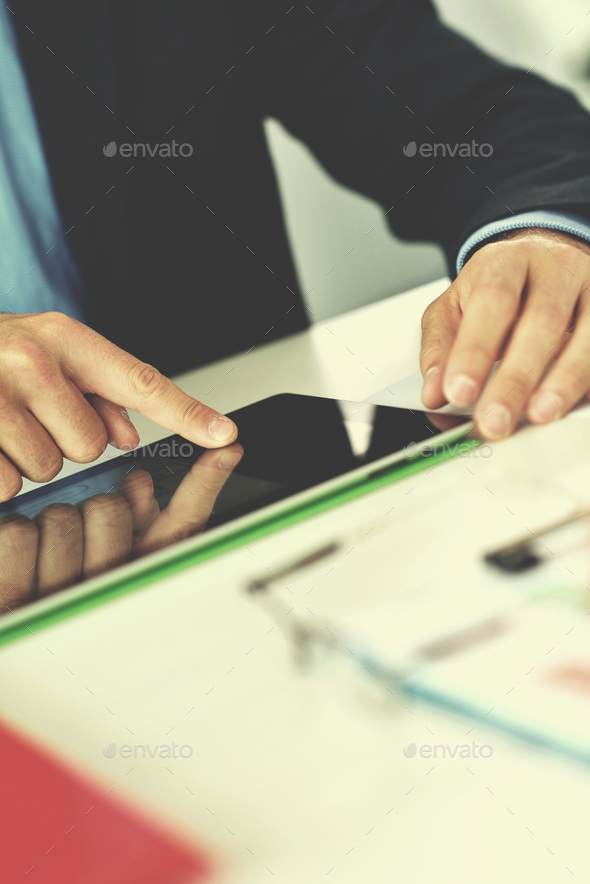 business man using tablet compuer at office - Stock Photo - Images