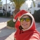 Happy Young Woman in Santa Hat Taking Selfie - VideoHive Item for Sale
