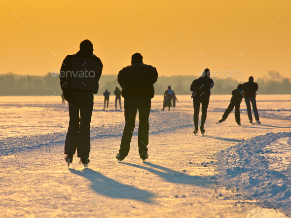 Skaters under setting sun - Stock Photo - Images