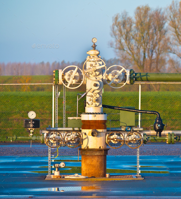 Natural gas production wellhead - Stock Photo - Images
