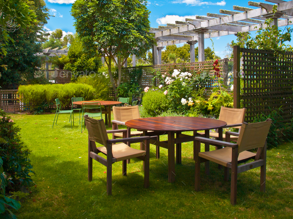 dining table set in lush garden - Stock Photo - Images