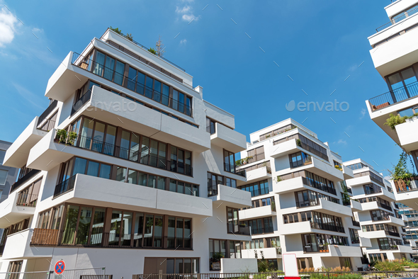 Modern white townhouses on a sunny day  - Stock Photo - Images