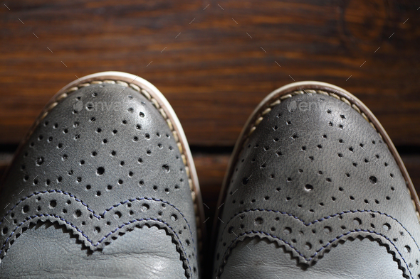 Grey oxford shoes on wooden background - Stock Photo - Images