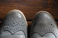 Grey oxford shoes on wooden background - PhotoDune Item for Sale