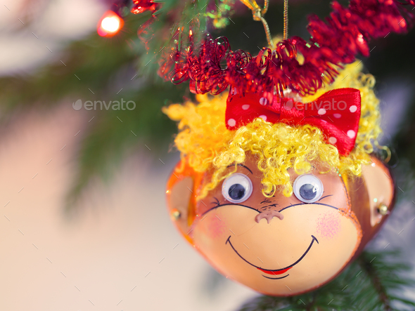 Smiling monkey christmas decoration - Stock Photo - Images