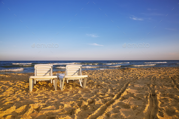 Two deckchairs on the sandy beach - Stock Photo - Images