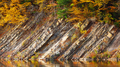 Rocky shore of lake in autumn time - PhotoDune Item for Sale