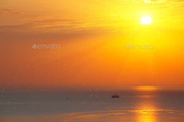 Panoramic dramatic sunset sky over sea at dusk - Stock Photo - Images