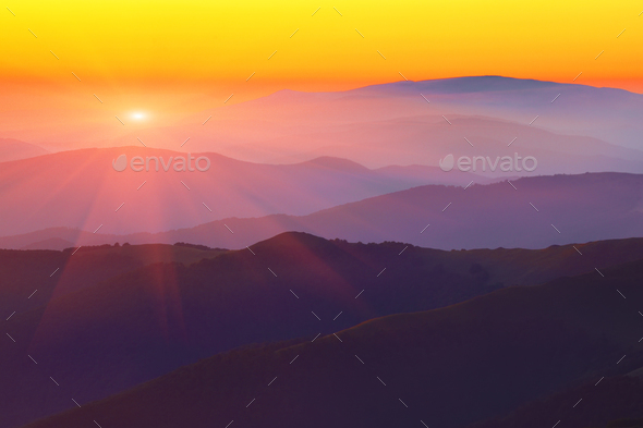 Silhouettes of the mountain hills at sunset - Stock Photo - Images